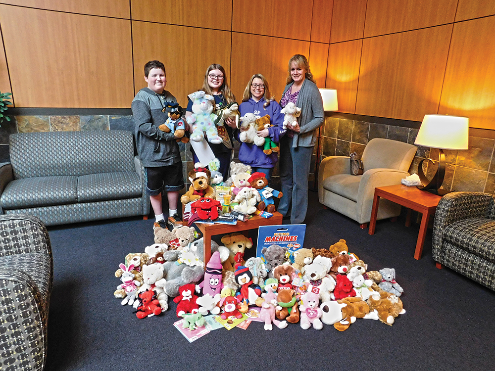 Girl Scout gives stuffed animals to local hospitals