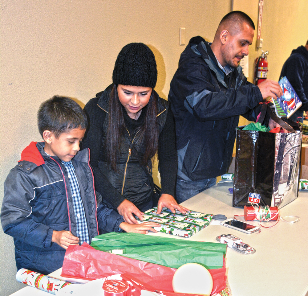 Carlos, Miriam and Damian Pineda help wrap gifts in 2016. (File)