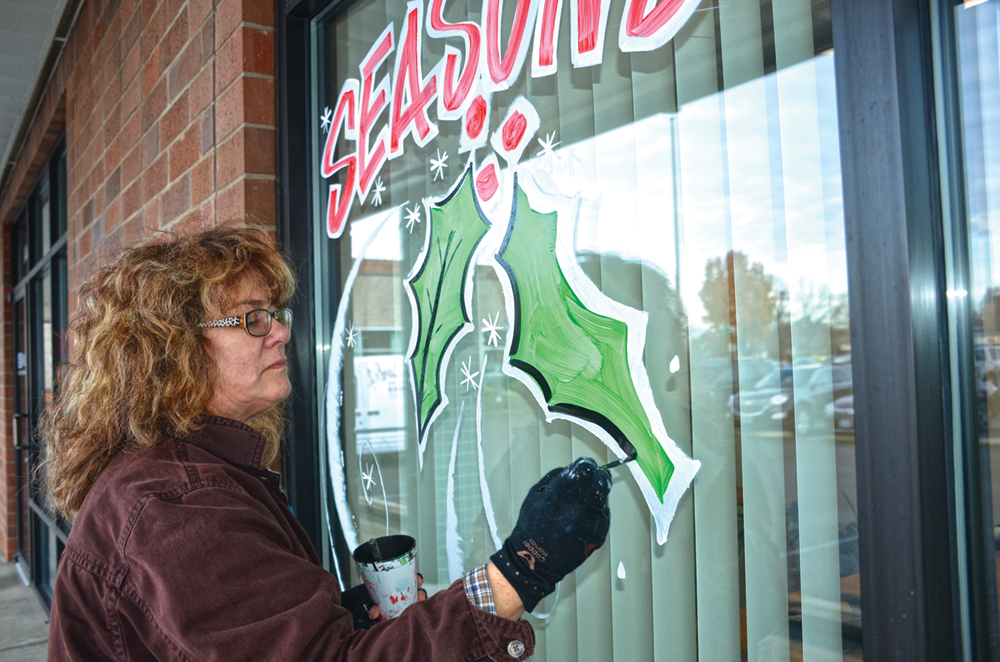 Artist paints the town with holiday cheer