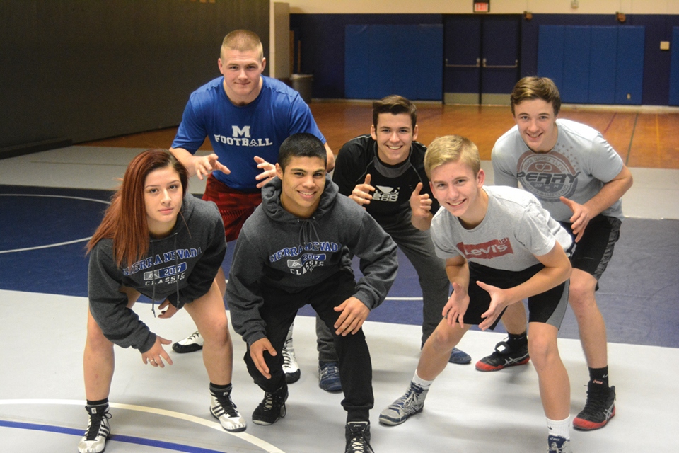 McNary wrestlers Nicolette Parra, front, from left, Enrique Vincent, Grady Burrows, Blake Norton, Nick Hernandez and Brayden Ebbs will compete in the state tournament on Feb. 16-17 in Portland. (Photo by KEIZERTIMES/Derek Wiley)