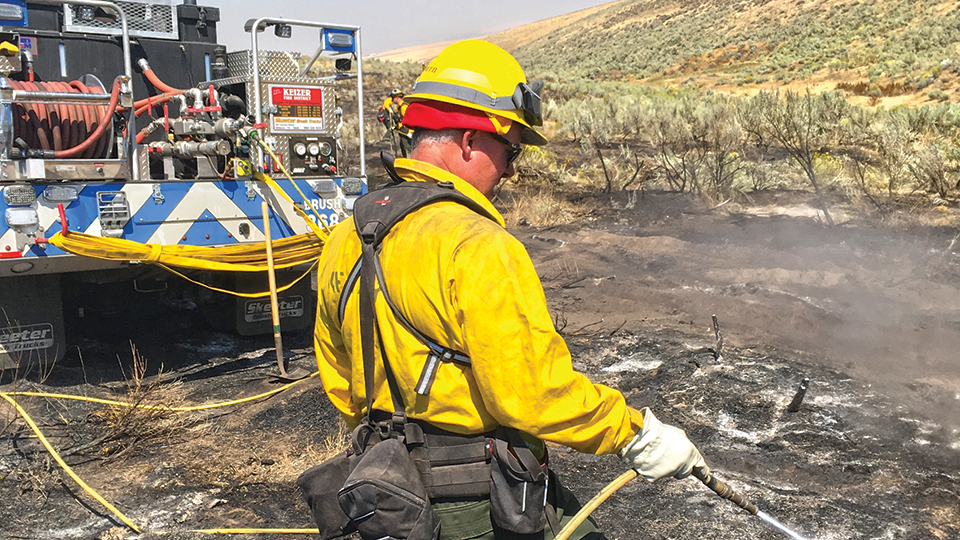 KFD linemen battle wildfires